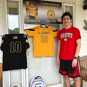 Saint Anthony's High School student stood next to sports uniform.